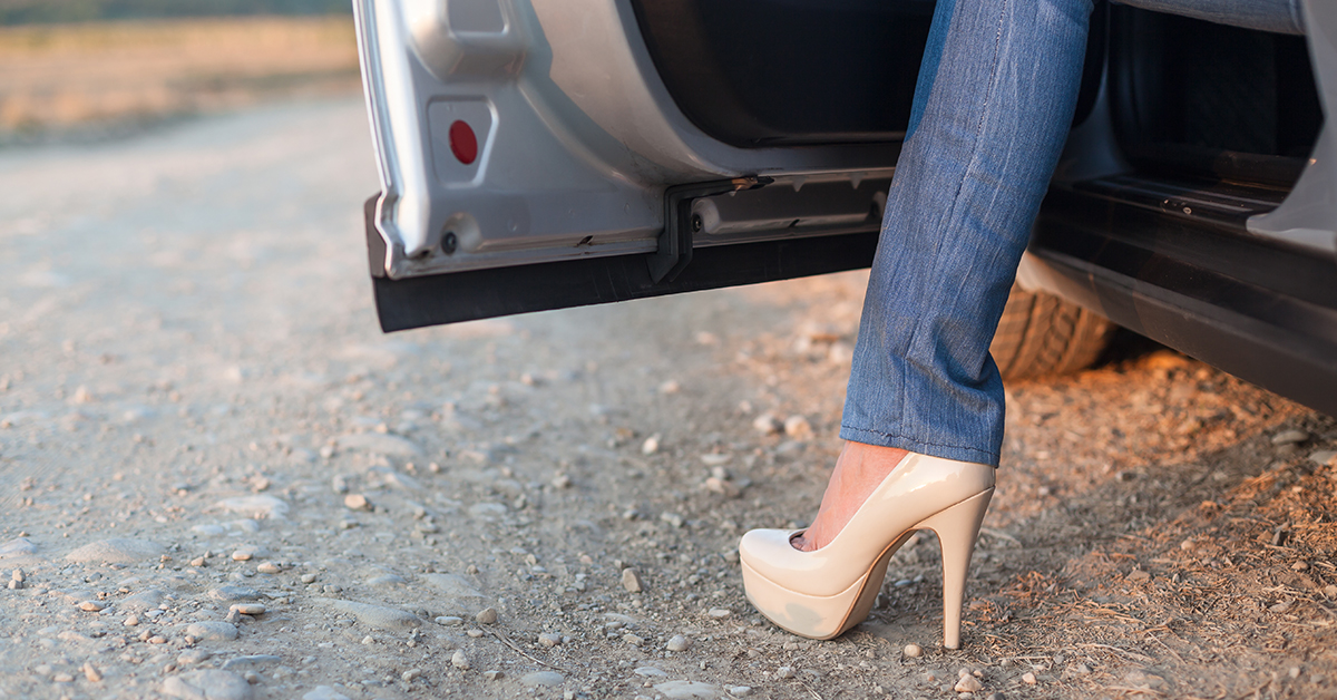 Female Stepping Out of Car